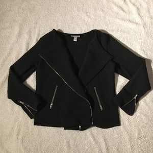 Black jacket with zipper detail.